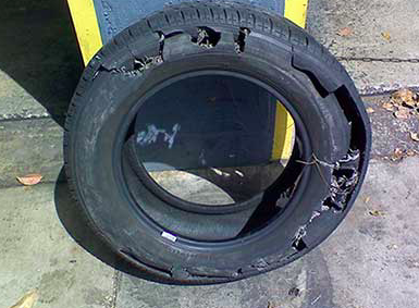 Car tire on motorcycle failure