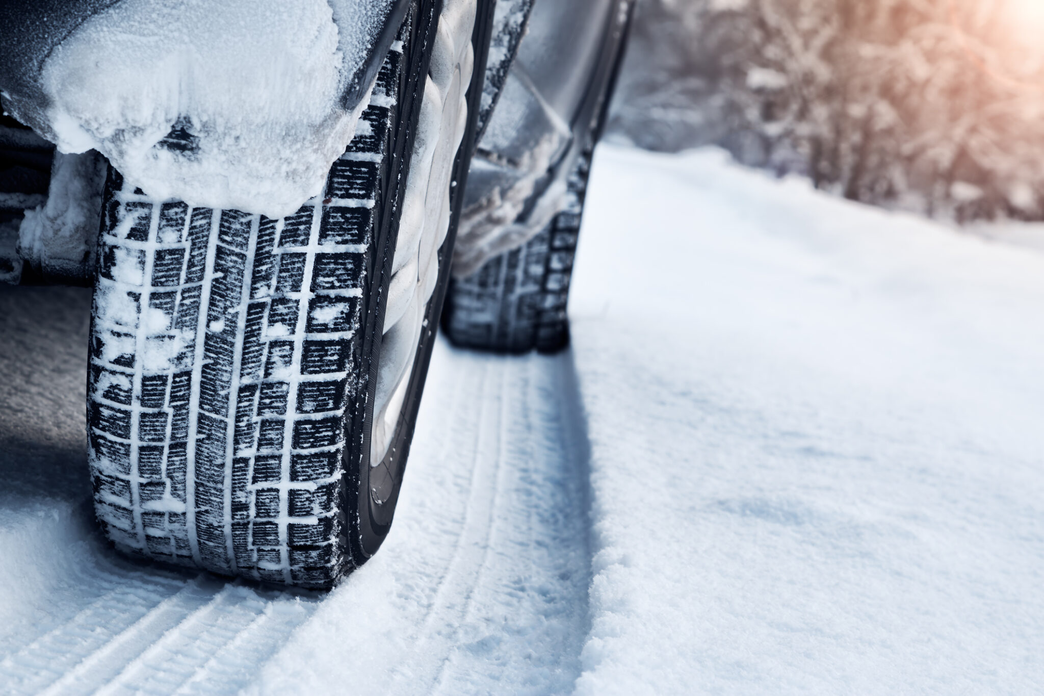 Winter tires on a road covered in snow