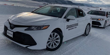 Bridgestone car driving on snow road
